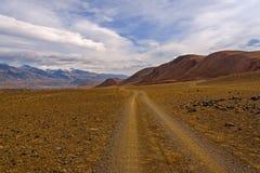 Mountain road valley sky Royalty Free Stock Photo