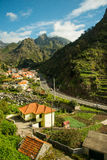 Mountain road view (2). Typical mountain village view of Madeira, Portugal. Tile roofs, white, light yellow and flaxen houses narrow (tight, restricted) roads stock photography