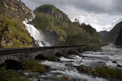 Mountain road and waterfall Royalty Free Stock Images