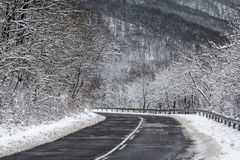 Mountain road in winter Stock Photos