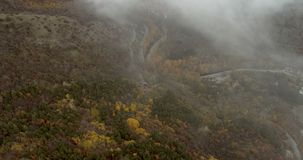 Mountain Roads With A Lot Of Mist. Fly Over Mountain Roads With A Lot Of Mist stock footage