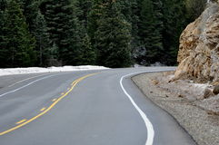 Mountain roadway leads to new adventures. Royalty Free Stock Photography