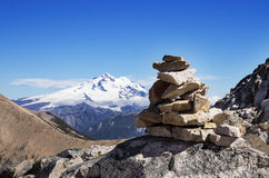 Mountain Rock Cairn. Rock cairn and Mount Tronador in the mountains near Bariloche Argentina royalty free stock images
