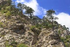 Mountain rock. Rock mountain cliff and blue sky Stock Photos