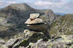 Mountain rock sign. Sign for hiking in the mountains: stones piled up by previous hikers royalty free stock photography