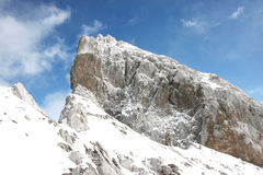 Mountain and rock and snow Stock Images
