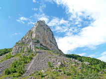 Mountain rock under sky. A large mountain and rock under a blue sky Stock Images