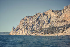 Mountain of rocks on the sea Stock Images