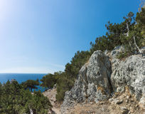 Mountain rocks on the shore of the Black Sea. Early autumn, the end of the holiday season Royalty Free Stock Photo