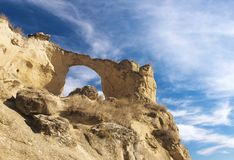 Mountain, rocks and sky. Yellow mountain with an arch Royalty Free Stock Photos