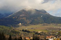 A mountain, a ruin and a village royalty free stock photography