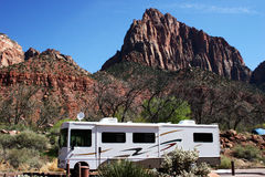 Mountain RV Trip. A motorhome parked at the foot of majestic mountains Stock Photo