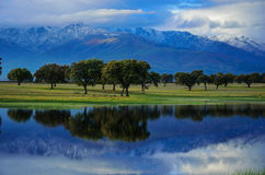 Mountain's lake. Lagoon at the foot of the Sierra de Gredos, with the characteristic oak forest Royalty Free Stock Photo
