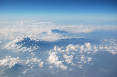 Mountain's peak from the sky. Peak of Mountain Slamet, Bali, Indonesia. Photographed from the window of a airplane royalty free stock images