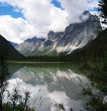 Mountain scene. Mount Harrison Smith reflected in Glacier Lake Stock Images