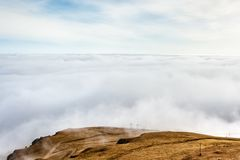 A mountain scene with clouds cover on a mountain hill.  royalty free stock image