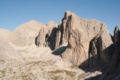 Mountain scene in The Dolomites. Beautiful mountain scene in The Dolomites,Rifugio giving scale Royalty Free Stock Photo