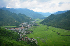 Mountain scene with paddy field and a village in Moc Chau Royalty Free Stock Photo