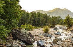 Mountain scene with river flowing Stock Image