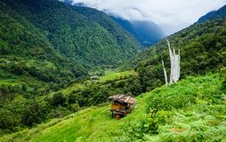 Mountain scenery in Bhutan. A shack on the hill at Highlands in Bhutan. Bhutan is a landlocked country in Asia and the smallest state located entirely within the Stock Images