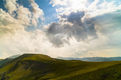 Mountain scenery with clouds above Stock Images