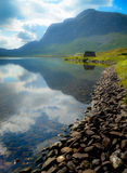 Mountain scenery with lake. And a boathouse in Norway stock photo