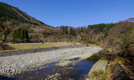 Mountain scenery in Gifu, Japan. Mountain scenery with a stream at sunny day in Gifu, Japan Stock Photo