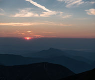 Mountain scenery at sunset with a series of peaks Stock Photo