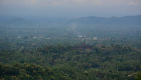 Mountain scenery of Yogyakarta, Indonesia. Misty mountain scenery with Borobudur Temple in Yogyakarta, Indonesia Royalty Free Stock Photos