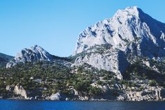 Mountain in the sea. Mountain sea bay rocks panoramic landscape stock images