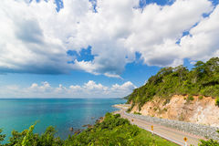 Mountain,sea and big clould blue sky with curve road Royalty Free Stock Photos