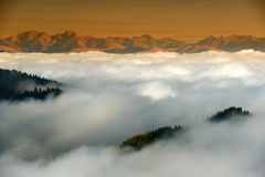 Mountain sea of clouds. Over the Transylvanian Alps, Romania Royalty Free Stock Photo