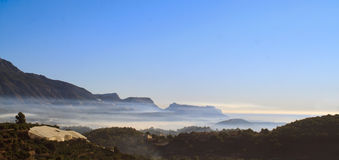 Mountain and sea mist Stock Photos
