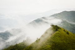 Mountain and sea of mist under the rain and cloudy sky view from. Suan Ya Luang at Nan province ,North of Thailand Royalty Free Stock Photos