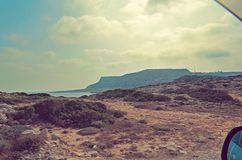 Mountain and sea scenery through the car window. Cyprus. Cape Greco Stock Photography