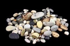 Mountain sea stones. On a black background Stock Photo
