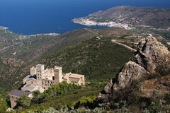 Mountain and sea. View on an abbey down from the mountain; sea and coastal town in the background (San Pere de Rodes monastery, Costa Brava, Spain royalty free stock photo