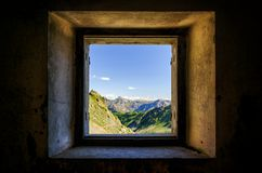 Mountain seen from an old window. Mountain Valley in the park of Mercantour France, Lakes of Lausfer seen from an old military barrack from the First World War Stock Photography