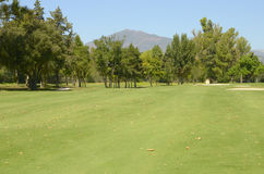 Mountain sees from a golf course Royalty Free Stock Photo