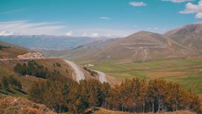 The Mountain Serpentine and Cars drive Along the Road in Armenia stock footage