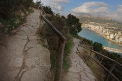 Mountain serpentine for a walk to Mount Ifach in Spain.  stock photos