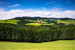 Mountain Settlement. Landscape of Austria with village in mountain range Royalty Free Stock Photos