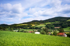 Mountain Settlement. Landscape of Austria with village in mountain range Stock Image