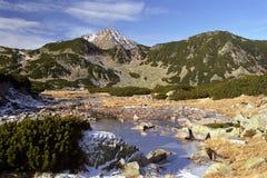 Mountain shape. Frozen small mountain lake on November Royalty Free Stock Images