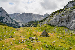 Mountain shelter in Durmitor National Park Montenegro. A hut in limestone mountains of Durmitor National Park in Montenegro in July stock images