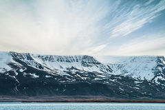 Mountain by the shore in Iceland. In cloudy weather Royalty Free Stock Photos