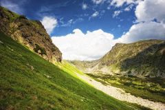 Mountain side with green grass Royalty Free Stock Images