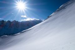 Untouched fresh powder slope in early winter bluebird day Stock Image