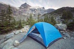 Mountain Side Tenting. A tent just set up for a night listening to the glacier calving above Joffre Lakes, BC, Canada Royalty Free Stock Image