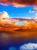 Mountain silhouette in the ocean at sunset. Royalty Free Stock Photography